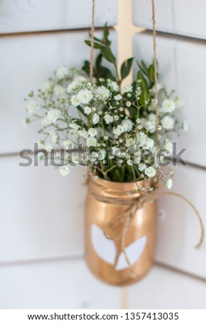 Spring decor. Easter decor. Photozone on a wooden white background. Vase with flowers #1357413035