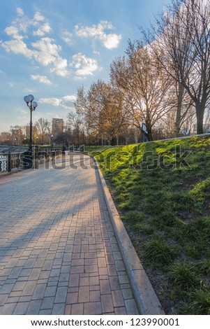 Spring embankment in Donetsk, the sun shines through the trees it