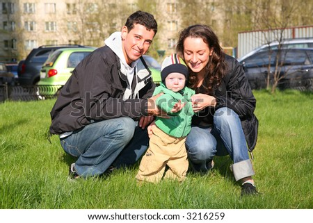 spring family with baby in yard