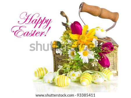 spring flowers and easter eggs on white background. happy easter. card concept