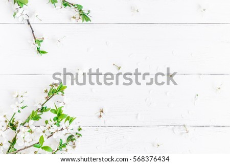 Spring flowers. Apple flowers on white wooden background. Flat lay, top view.