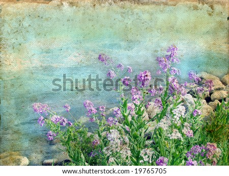 Spring flowers by the water on a grunge background.