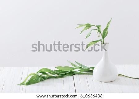 spring flowers in a vase #610636436