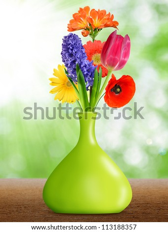 spring flowers in the green decorative vase