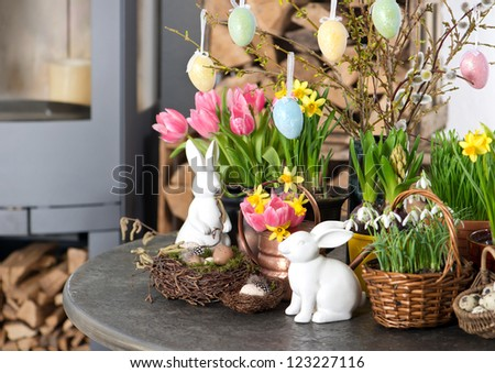 spring flowers with easter eggs decoration. tulips, snowdrops and narcissus blooms on white background. selective focus