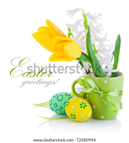 spring flowers with easter eggs isolated on white background