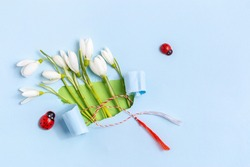 Spring greeting card made from torn paper with Snowdrops (Galanthus nivalis) flowers over. Spring, 8 March, Martisor, Baba Marta holiday concept. Place for text