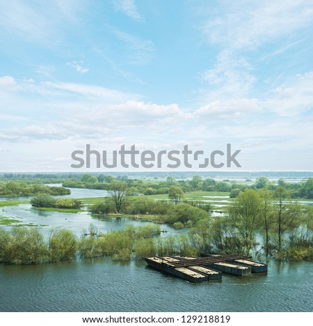 Spring high water. Elements of the old pontoon bridge on the Sozh River, Belarus