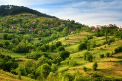 Spring is coming... Amazing spring view with a little village in Rhodopi Mountains, Bulgaria. Magnificent landscape, green fields, small houses - Image