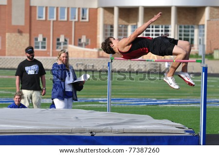 SPRING LAKE PARK, MN - May 7: Unidentified Teen Boy Doing the High Jump at a High School Track and Field Meet on May 7, 2010 in Spring Lake Park, Minnesota.