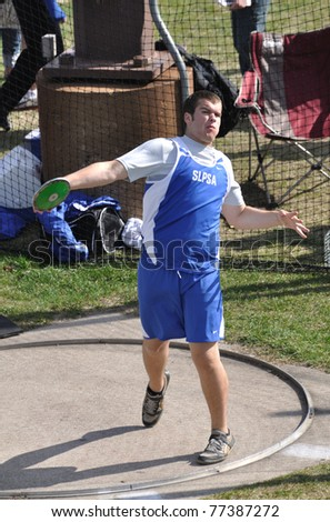 SPRING LAKE PARK, MN - May 3: Unidentified Teen Boy Throwing the Discus at a High School Track and Field Meet on May 3, 2011 in Spring Lake Park, Minnesota.