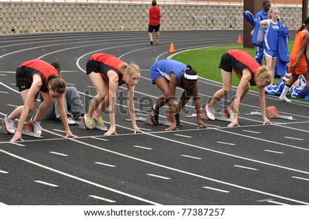 SPRING LAKE PARK, MN - May 7: Unidentified Teen Girls in the Starting Blocks at a High School Sprint Race on May 7, 2010 in Spring Lake Park, Minnesota.