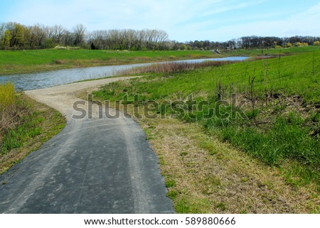 Spring landscape in the natural park with country road #589880666