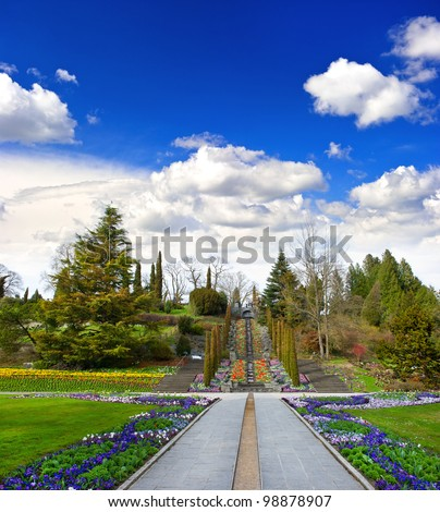 spring landscape with flowers and beautiful blue sky. public flower garden Mainau Island in Germany