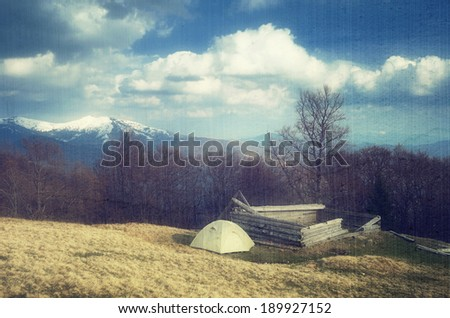 Spring landscape with the beautiful sky. Camping in the mountains. Carpathians, Ukraine, Europe. Filtered image: vintage, grunge and texture effects