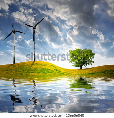 spring landscape with wind turbine in the sunset