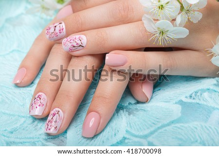 Spring manicure for the bride in gentle tones with flowers. Nail Design. Close-up.