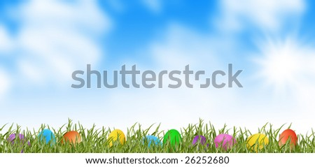spring meadow and colorful easter eggs in grass