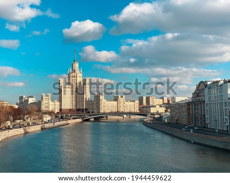 Spring Moscow. View of a high-rise building on Kotelnicheskaya embankment. Stalinist Empire style. View from the floating bridge over the Moscow River. cityscape Stock photo ©