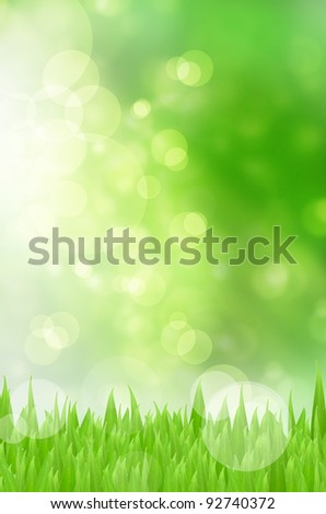 Spring nature background with grass and bokeh lights