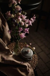 Spring naturemorte with pink flowers and gray crock