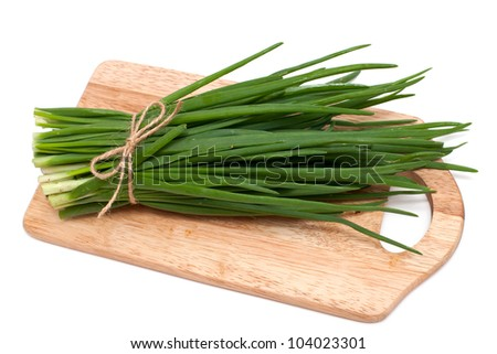 spring onion on cutting board isolated on white