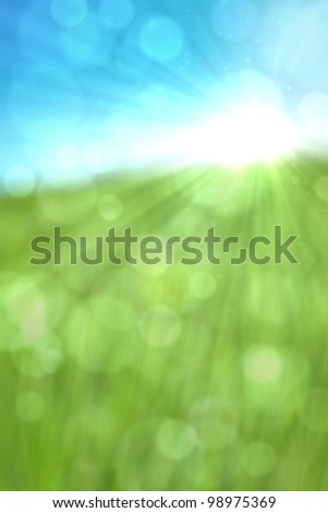 Spring or summer abstract nature background with glitter, bokeh and sun