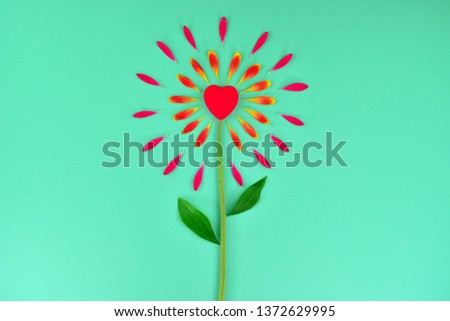 Spring or summer floral background with copy space for text. Flat lay. Floral background with hearts. Beautiful flower from petals. Flower petals on a  turquoise background. Flower petals and heart. #1372629995