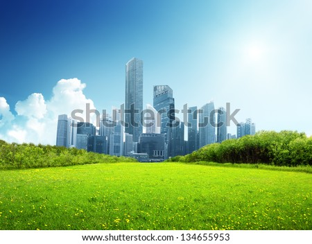 spring park and modern city - stock photo