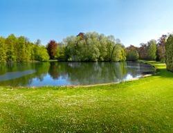 Spring Park. Lake in the spring park. Spring landscape.