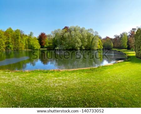 Spring Park. Lake in the spring park. Spring landscape.   #140733052