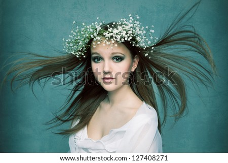 spring portrait  girl with wreath of flowers