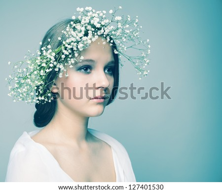 spring portrait  girl with wreath of flowers , pastel shades