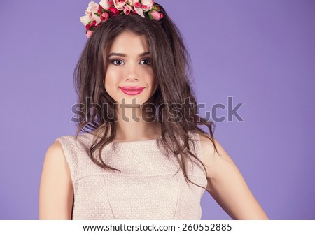 Spring portrait of a beautiful delicate girl with flowers in her hair #260552885