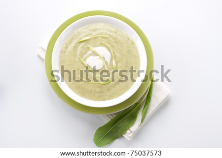 Spring ramson soup in bowl on white background