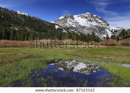 Spring reflections of Carson Peak near June Lake in eastern Sierra Nevada mountains of California