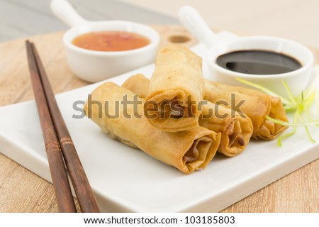Spring Rolls - Fried duck spring rolls served with soy sauce and sweet chili dip.