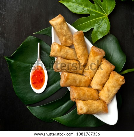 spring rolls on the black board with spicy saus sweet an sour  vegan vegetarian gluten free sugar free stuffed with  chicken soya vegetables fried palm oil free