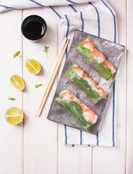 Spring rolls with vegetables served with soy sauce and lime
