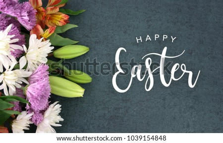 Spring season still life with Happy Easter calligraphy holiday script over dark blackboard background texture with beautiful colorful white, pink, orange, purple and green flower blossom bouquet #1039154848
