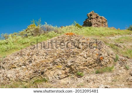 Spring seasonal Landscape with unusual color of igneous rocks on Volcanic mountain range Kara-Dag located in Eastern Crimea Stockfoto ©
