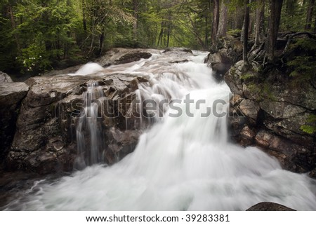 Spring stream and waterfalls in the shite mountains of New Hampshire after a storm,Kancamagus.swift river,horizontal