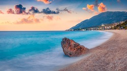 Spring sunrise in Dhermi town. Calm morning seascape of Adriatic sea with endless horizon. Amazing spring scene of Albania, Europe. Traveling concept background.
