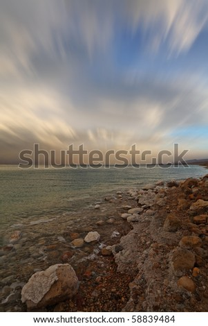 Spring thunder over the Dead Sea. Sunset and the flying clouds