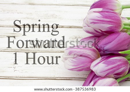 Spring Time Change, Some tulips with weathered wood and text Spring Forward 1 Hour #387536983