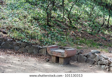 Spring time: stone bench in the garden