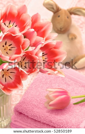 Spring tulips with the Easter bunny soft toy