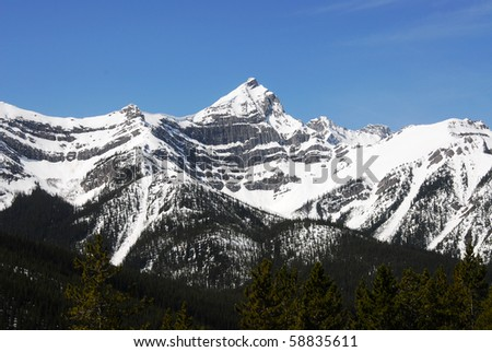 spring view of canadian rocky mountains and avalanche areas in kananaskis, alberta, canada - stock photo