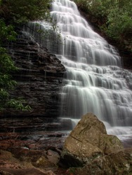 Spring waterfall with boulders in the foreground. Benton Falls.