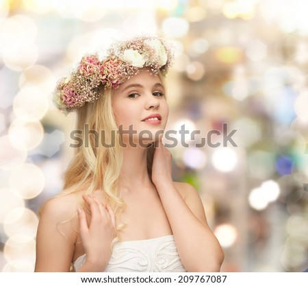 spring, wedding and people concept - young woman wearing wreath of flowers